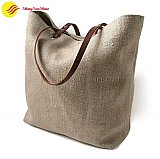 Custom portable jute tote handbag with leather handles.