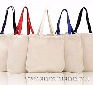 Custom cotton tote shopping bags with handles.